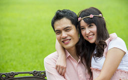 Lovely couple sit in the garden3 Royalty Free Stock Photography