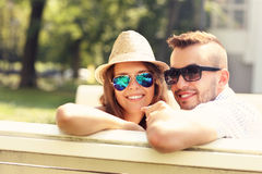 Lovely couple sitting on the bench Royalty Free Stock Photo