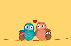 Lovely couple sitting owl on the rope with children owlet. Family Royalty Free Stock Photo