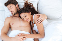 Lovely couple sleeping on their bed at home Royalty Free Stock Images