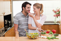 Lovely couple slicing pepper Stock Photography