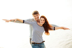 Lovely couple smiling on beach Stock Photo