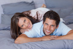 Lovely couple smiling at camera Stock Photo