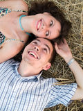 Lovely couple in straw. Lovely young couple lying in straw in filed Stock Images