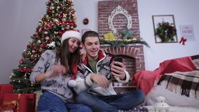 Lovely couple talking by mobile video chat with relatives and waving hello. stock footage