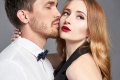 Lovely couple in tender passion. Bearded handsome men kissing a Beautiful woman.beauty girl and boy together Royalty Free Stock Photos
