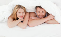 Lovely couple in their bed Stock Photo