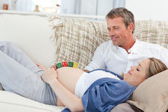 Lovely couple on their couch Stock Image