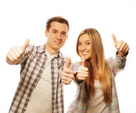 Lovely couple with thumbs-up gesture isolated on white Stock Photography