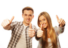 Lovely couple with thumbs-up gesture Royalty Free Stock Photography