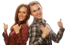 Lovely couple with thumbs-up gesture Royalty Free Stock Images