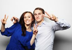 Lovely couple with thumbs-up gesture Stock Photo