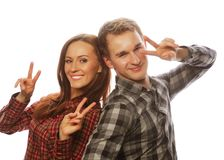 Lovely couple with thumbs-up gesture Stock Photos