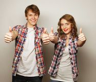 Lovely couple with thumbs-up gesture Royalty Free Stock Photo