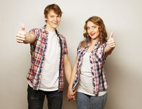 Lovely couple with thumbs-up gesture Royalty Free Stock Image