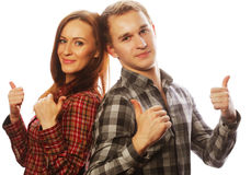 Lovely couple with thumbs-up gesture Stock Image