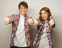 Lovely couple with thumbs-up gesture Stock Photography