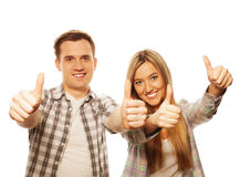 Lovely couple with thumbs-up gesture  on white Royalty Free Stock Image