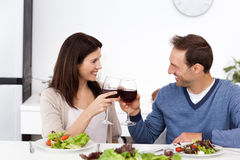 Lovely couple toasting glasses of red wine Stock Image