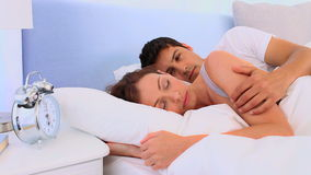 Lovely couple waking up in their bed