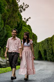 Lovely couple walk together in the garden1 Royalty Free Stock Photos