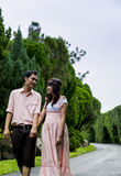 Lovely couple walk together in the garden3 stock photo