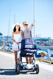 Lovely couple walking with a baby pram Royalty Free Stock Photos