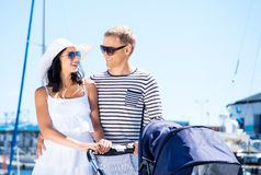 Lovely couple walking with a baby pram Stock Photography
