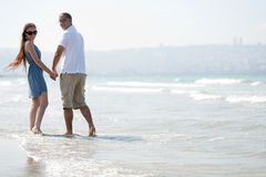 Lovely Couple walking at the beach Stock Photo