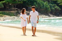 Lovely couple walking on beach together Stock Photography
