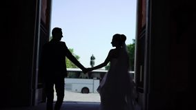 Lovely couple walking in a city. Slowmotion stock footage