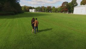 Lovely couple walking in park. Shot stock footage