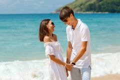 Lovely couple walking on a tropical beach Stock Photography