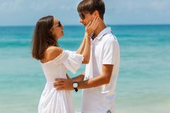 Lovely couple walking on a tropical beach Royalty Free Stock Photo