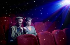 Lovely couple watching 3D movie. With little sparkling stars around Royalty Free Stock Photography