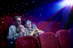 Lovely couple watching 3D movie. With little sparkling stars around Stock Image