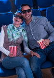 Lovely couple watching a 3d movie Stock Photography