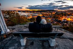 Lovely couple watching sunset in Sandefjord Vestfold Norway stock photos