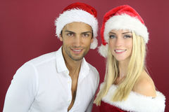 Lovely couple wearing a Santa hat Stock Photos