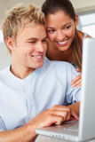 A lovely couple working on a laptop Stock Images