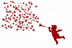 Lovely cupid with a trumpet and red hearts royalty free stock photo