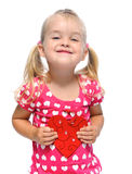 Lovely cute girl with red heart. Smiling blonde girl with valentine heart is isolated in studio stock image