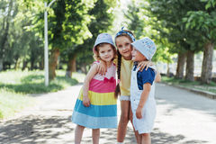 Lovely cute kids playing in the park a beautiful summer. Sunny day Stock Image