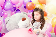 Lovely dark-haired girl posing with teddy bears Royalty Free Stock Images