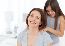 Lovely daughter brushing her woman hair Stock Photography