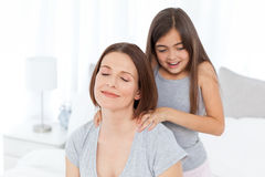 Lovely daughter brushing her woman hair Royalty Free Stock Photos