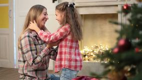 Mother and daughter hugging at Christmas at home stock footage