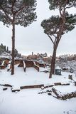 A lovely day of snow in Rome, Italy, 26th February 2018: a beautiful view of Colosseum under the snow.  royalty free stock photo