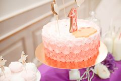 Beautifully decorated children`s party with balloons flowers and sweets. A lovely delicious candy bar in pink and purple colors for a little princess on her 1st Stock Photography