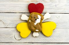 Lovely doggy and hearts on a white background. Christmas gingerbread. Lovely doggy and hearts on a white background Stock Images